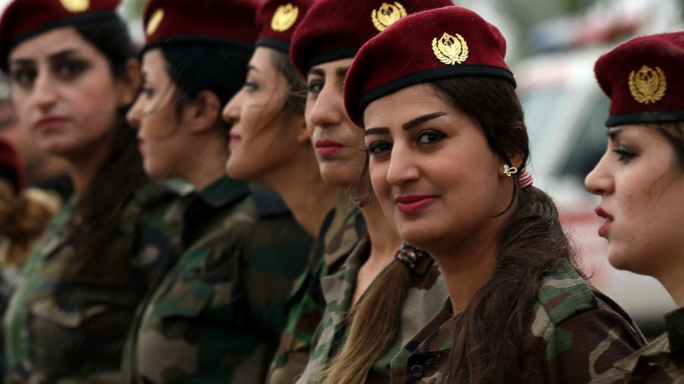Kurdish Peshmerga female fighters march during a training camp conducted by trainers from the German military forces in Arbil, the capital of the Kurdish autonomous region in northern Iraq, Oct. 27, 2015.