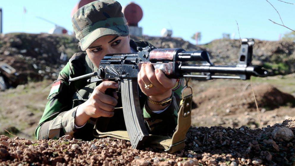 A female fighters aims her rifle as part of the Syrian Peshmerga fighters training to fight against Daesh and Assad forces at a camp located in Old Mosul region of the city of Nineveh, Iraq, Dec. 9, 2015.
