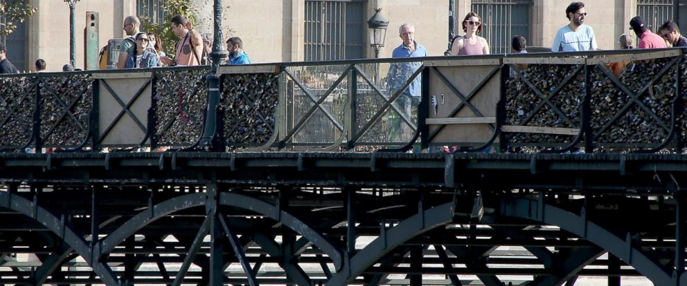 PHOTO: Officials from Paris City Hall have placed plastic panels in order to prevent tourists from attaching love padlocks on the Pont Des Art bridge, Sept. 21, 2014, in Paris.