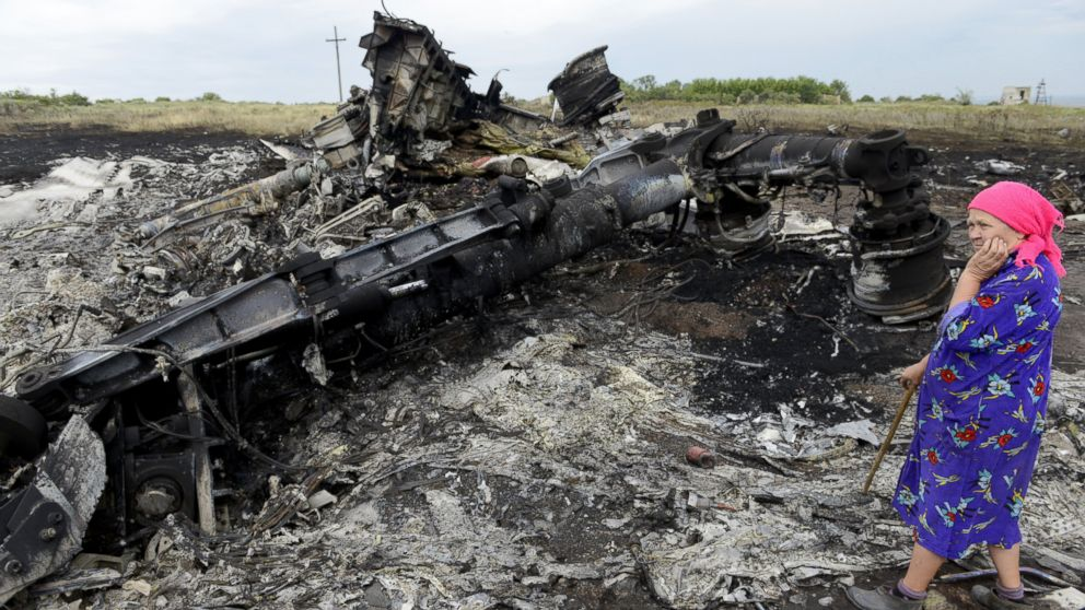 A local resident stands among the wreckage at the site of the crash of a Malaysia Airlines plane carrying 298 people from Amsterdam to Kuala Lumpur in Grabove, in rebel-held east Ukraine, on July 19, 2014.