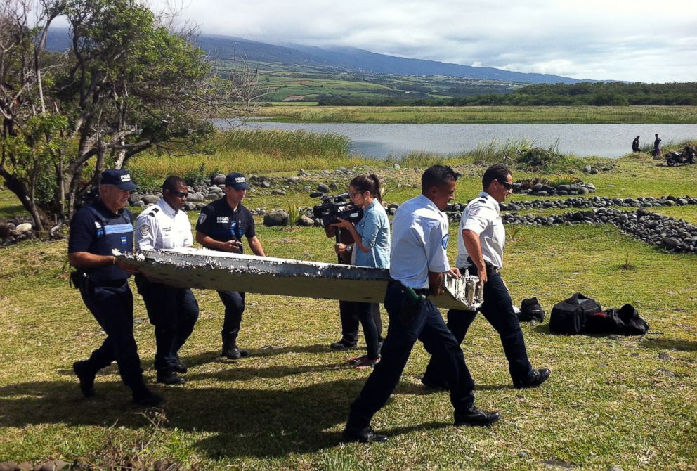 PHOTO:Police carry a piece of debris from an unidentified aircraft found in the coastal area of Saint-Andre de la Reunion, in the east of the French Indian Ocean island of La Reunion, July 29, 2015.  'Extremely disappointing:' Another MH370 search ends 'Extremely disappointing:' Another MH370 search ends GTY malaysian airlines 02 mm 160307 hpEmbed 1 22x15 992