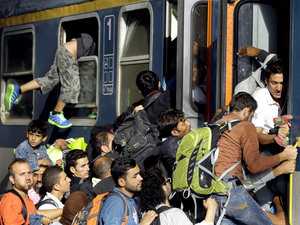 PHOTO: Migrants board into a local train heading to the Hungarian-Austrian border at the main train station in Budapest, Sept. 3, 2015, after authorities re-opened the station to refugees.