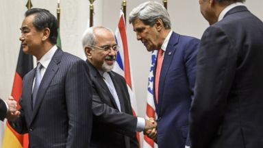PHOTO: Iranian Foreign Minister Mohammad Javad Zarif (2nd L) shakes hands with U.S. Secretary of State John Kerry after a statement on early Nov. 24, 2013 in Geneva.