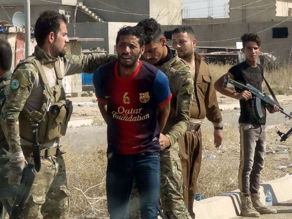PHOTO: Iraqi Kurdish security forces detain a suspected member of the Islamic State (IS) group as they patrol the eastern suburbs of Kirkuk on Oct. 22, 2016, after jihadist gunmen attacked the city.