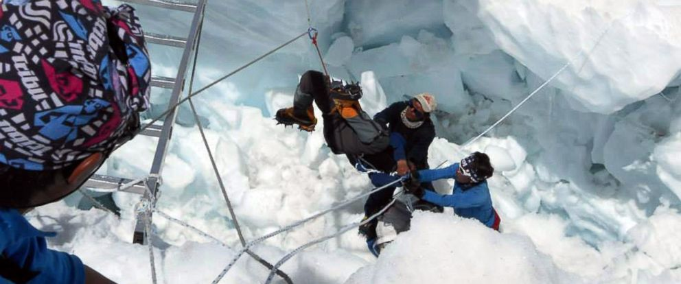 PHOTO: Nepalese rescue team members rescue a survivor of an avalanche on Mount Everest on April 18, 2014.