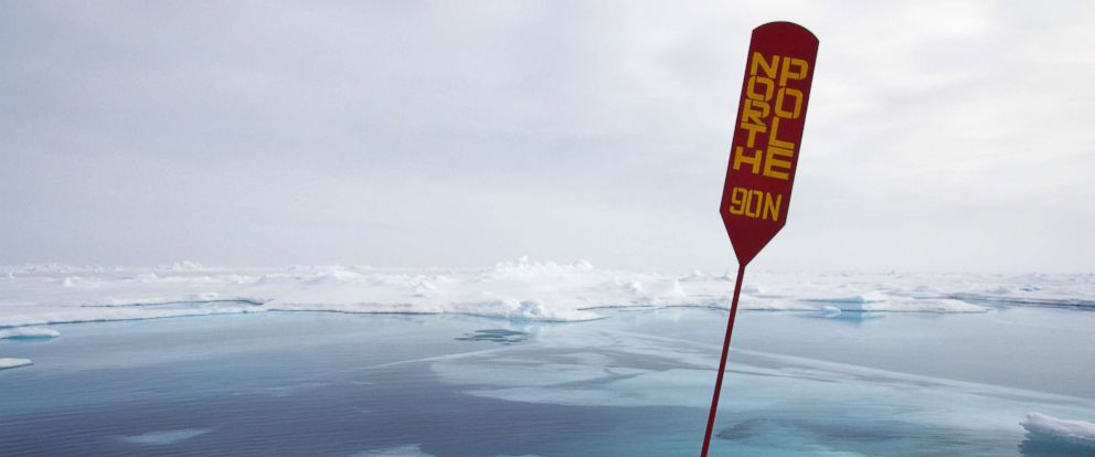 PHOTO:A sign indicating North Pole is seen among melting ice in this undated file photo.