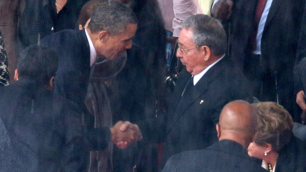 President Barack Obama shakes hands with Cuban President Raul Castro during the official memorial service for former South African President Nelson Mandela at FNB Stadium, Dec. 10, 2013, in Johannesburg, South Africa.