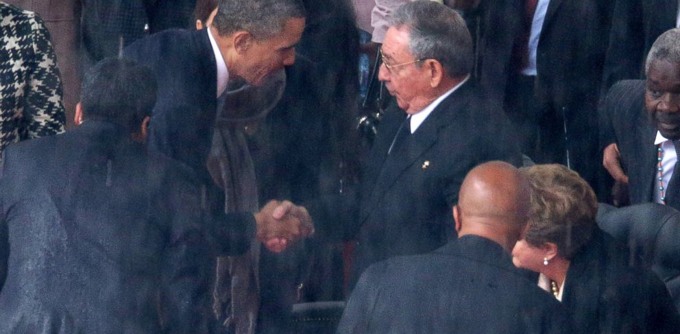 PHOTO: President Barack Obama shakes hands with Cuban President Raul Castro during the official memorial service for former South African President Nelson Mandela at FNB Stadium, Dec. 10, 2013, in Johannesburg, South Africa.