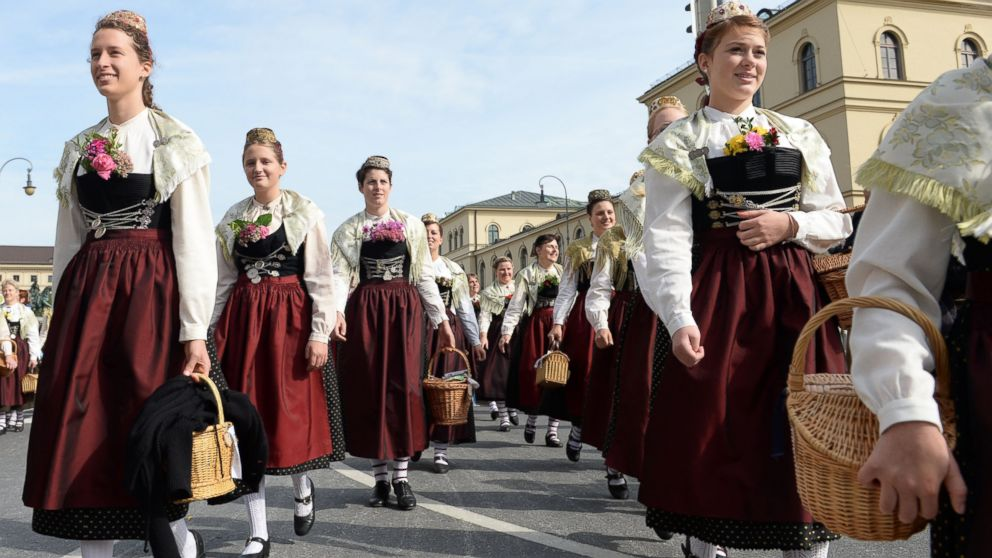Women wearing the traditional dirndl take part in the traditional costume parade of the Oktoberfest beer festival in front of the Odeons church in Munich, Germany, Sept. 22, 2013.
