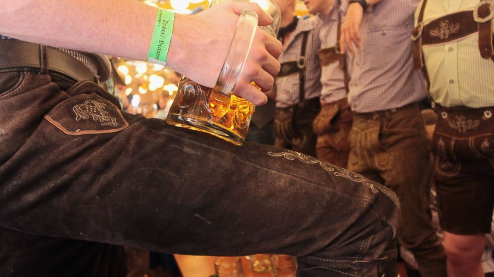 Revelers dressed with traditional Bavarian Lederhosen trousers enjoy drinking beer during day 2 of the Oktoberfest 2011 beer festival at Theresienwiese, Sept. 18, 2011 in Munich, Germany.