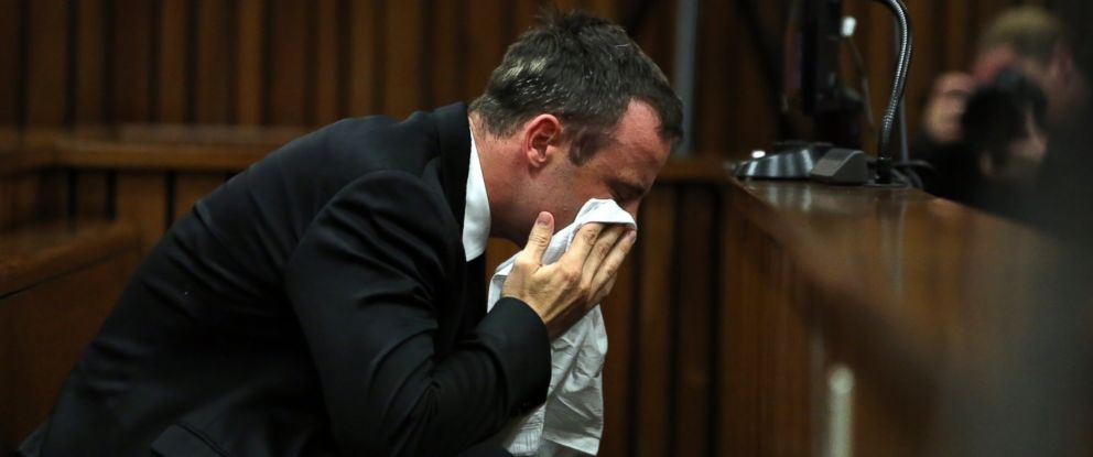 PHOTO: Oscar Pistorius wipes his face during his trial in Pretoria, South Africa on April 7, 2014.