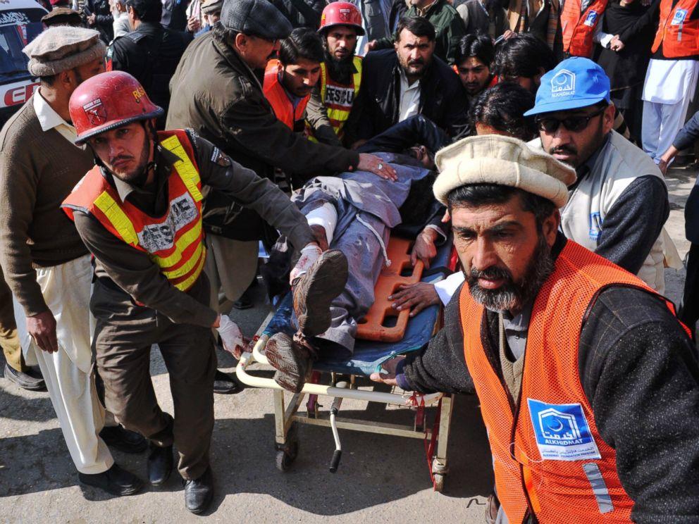 PHOTO: Pakistani rescuers shift an injured man to a hospital following an attack by gunmen in the Bacha Khan university in Charsadda, Peshawar, Jan. 20, 2016.