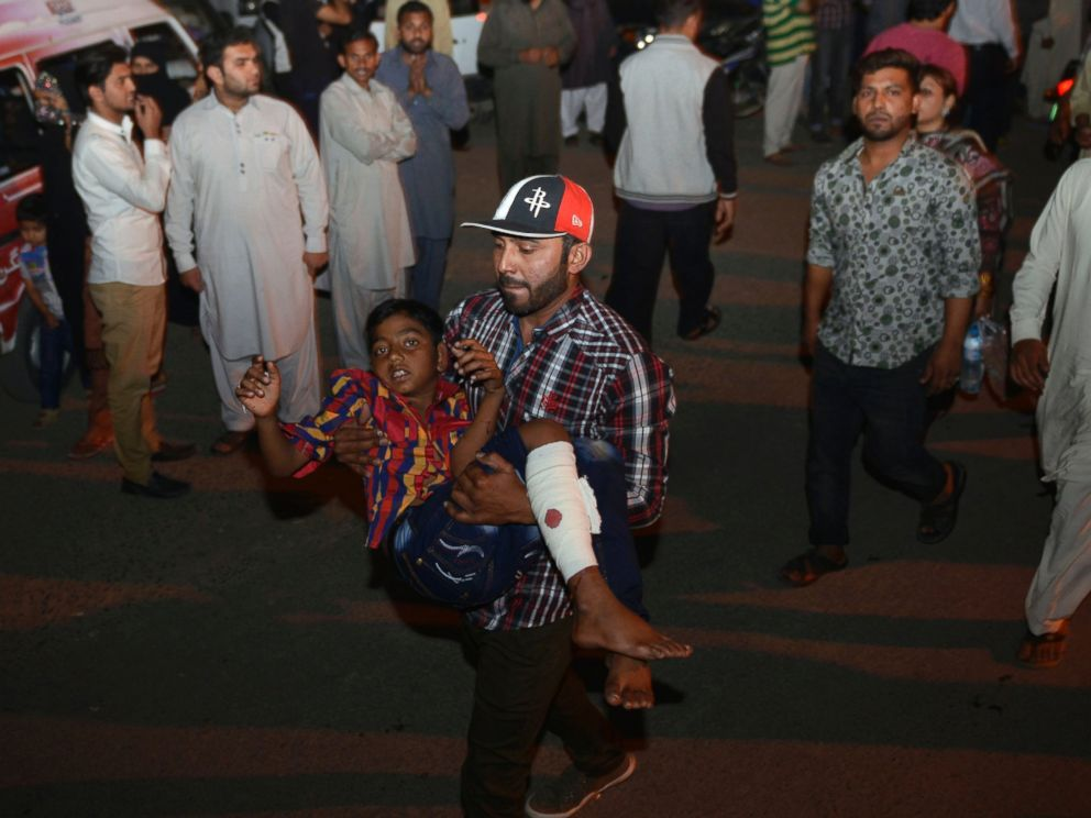 PHOTO: A Pakistani relative carries an injured child to the hospital in Lahore, March 27, 2016, after an apparent suicide bomb ripped through the parking lot of a crowded park in the Pakistani city of Lahore where Christians were celebrating Easter.