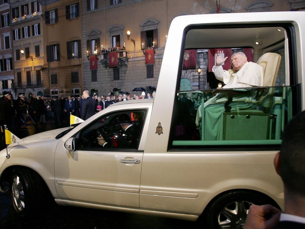 PHOTO: Pope John Paul II blesses the statue of the Virgin Mary on Dec. 8, 2004 as he leaves in his Popemobile from Romes central square of Piazza di Spagna, after celebrating the traditional feast of the Immaculate Conception.