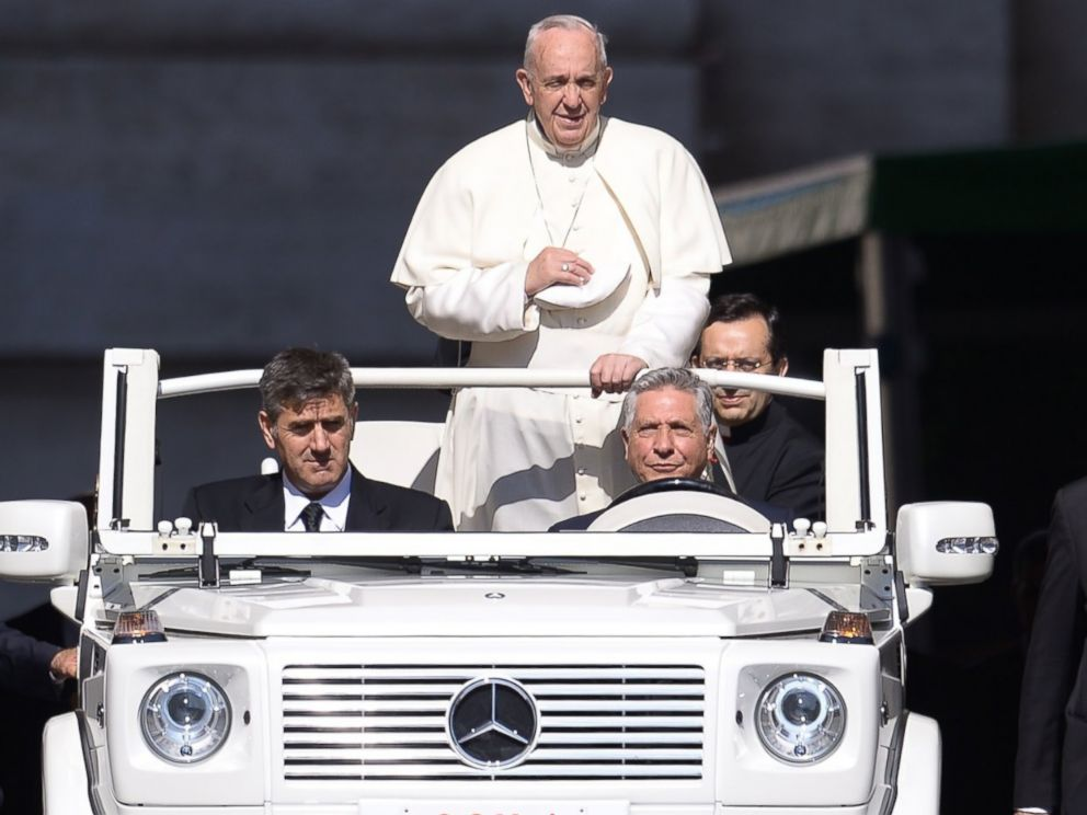 PHOTO: Pope Francis stands on the Popemobile as he arrives for his weekly general audience at St Peters Square on June 10, 2015 at the Vatican.