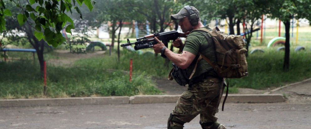 PHOTO: Pro-Russia militants shoot from a residential building at border guards defending the Federal Border Headquarters building in the eastern Ukrainian city of Lugansk on June 2, 2014.