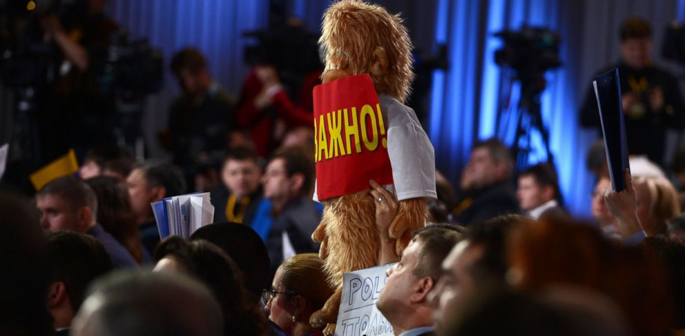 PHOTO: A journalist raises up a plush toy for questions at a press conference