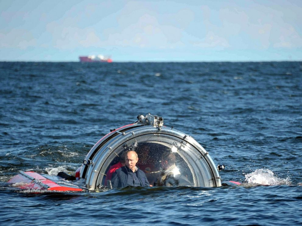 PHOTO: Russian President Vladimir Putin submerges on board Sea Explorer 5 bathyscaphe near the isle of Gogland in the Gulf of Finland, July 15, 2013, visiting Oleg frigate which sink in 1869.