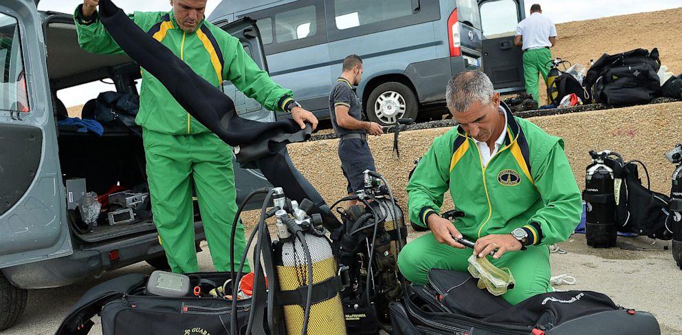 PHOTO: A Guardia di Finanza diver prepares his equipment