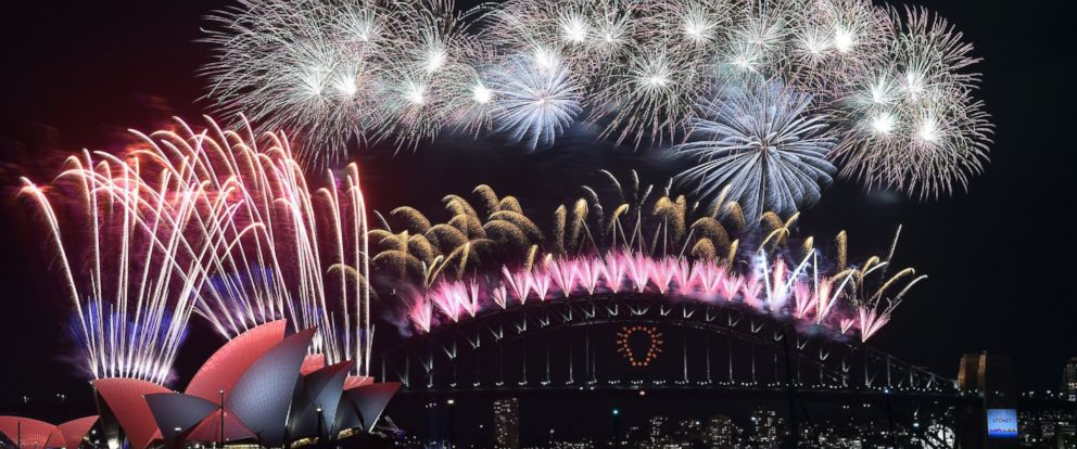 PHOTO: New Years fireworks erupt over Sydneys iconic Harbour Bridge and Opera House during the traditional fireworks at midnight, Jan. 1, 2015.