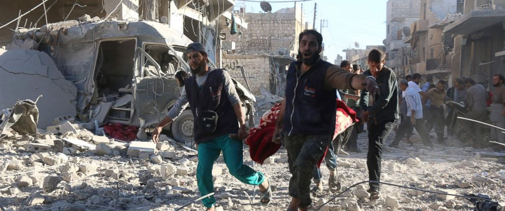 PHOTO: Syrian volunteers carry an injured person on a stretcher following Syrian government forces airstrikes on the rebel held neighbourhood of Heluk in Aleppo, Sept. 30, 2016.