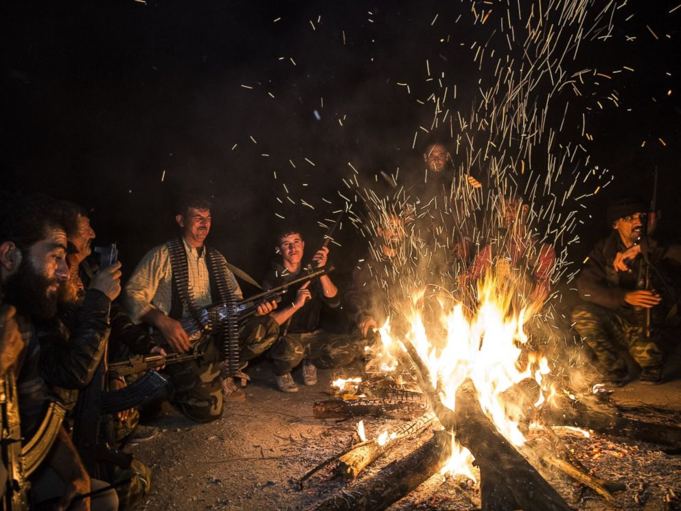 PHOTO: Turkmen soldiers gather around fire at night in the Bayirbucak region in Syria, Oct. 27, 2015.