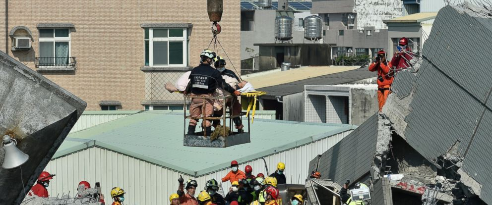 PHOTO: Rescue workers use a crane to transport a survivor found in the rubble at the Wei-kuan apartment complex on the second day of rescue operations following a 6.4 magnitude earthquake in southern Taiwans city of Tainan, Feb. 7, 2016.