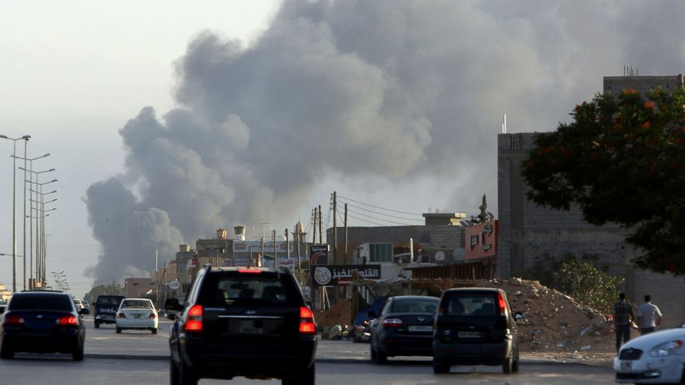Smoke billows from an area near Tripoli's international airport as fighting between rival factions around the capital's airport continues on July 24, 2014.