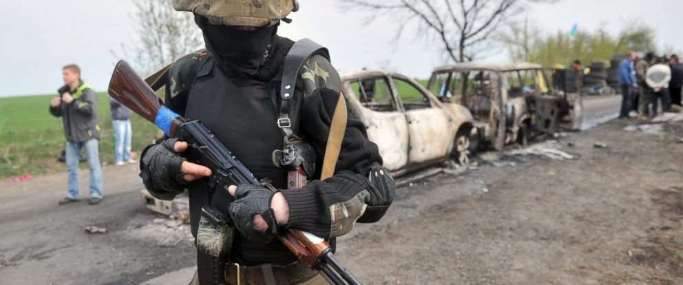 PHOTO: An armed pro-Russian militiant stands guard at a check-point outside the eastern Ukrainian city of Slavyansk, on April 20, 2014.