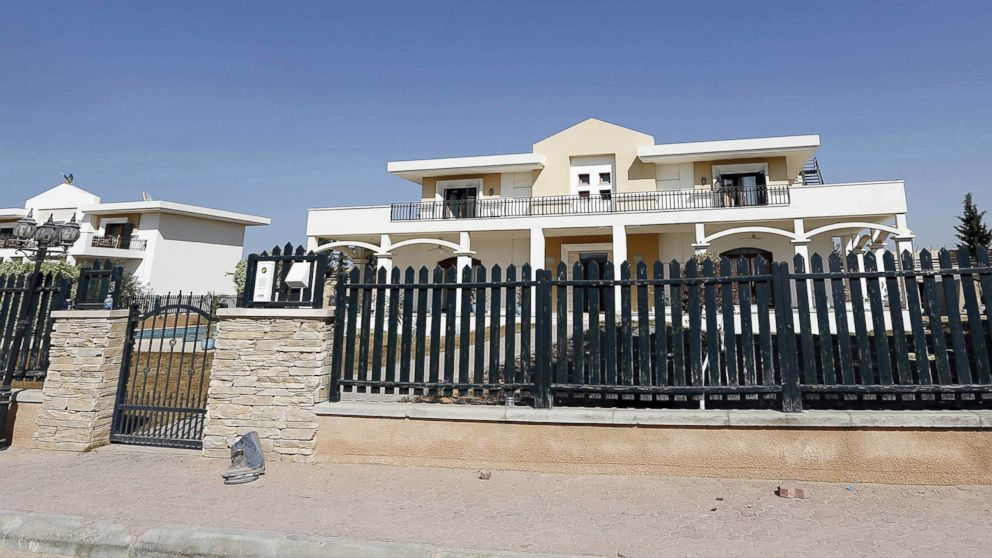 An exterior view of the US diplomatic compound in Libya that is allegedly under the control of members of the Fajr Libya, in Tripoli, Libya, Aug. 31, 2014.