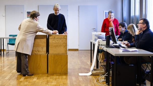 PHOTO: A woman casts her ballot during a nationwide popular vote on Feb. 9, 2014 in Ascona, Switzerland.