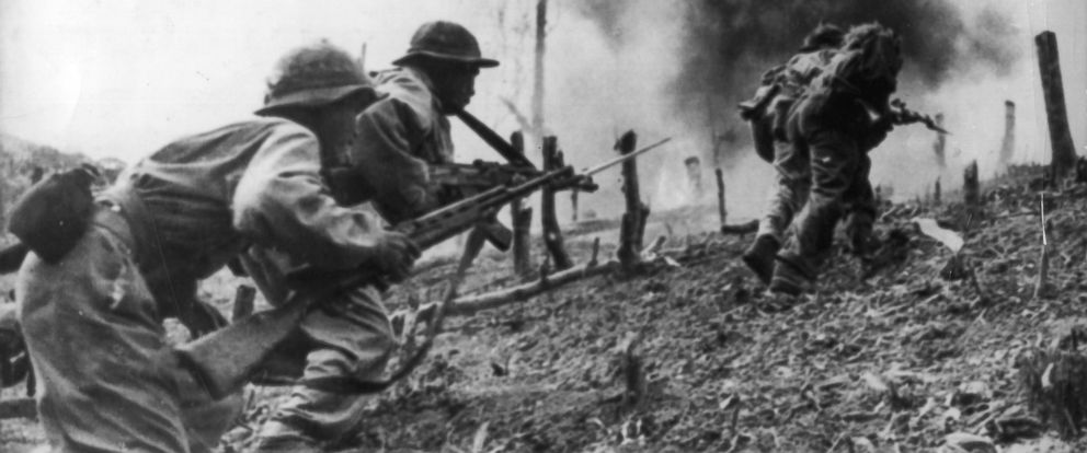 PHOTO: North Vietnamese troops during an assault on a South Vietnamese paratroop base at Laos during the Vietnam War.