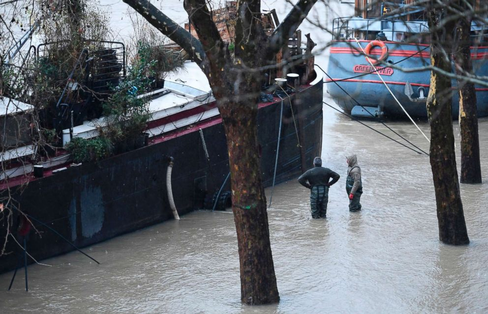 PHOTO: Paris shows People stand in flood water along the banks of the Seine river in Paris, Jan. 22, 2018.