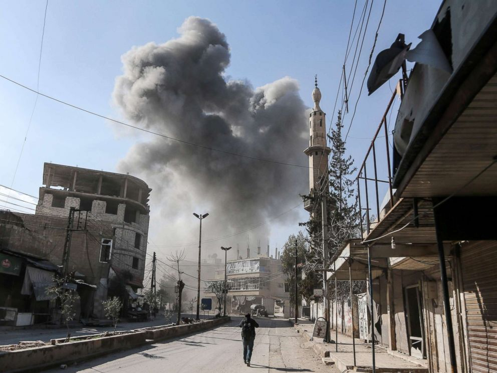PHOTO: A smoke plume rises following a reported regime air strike on Feb. 21, 2018 in the rebel-held enclave of Hamouria in the Eastern Ghouta near Damascus.