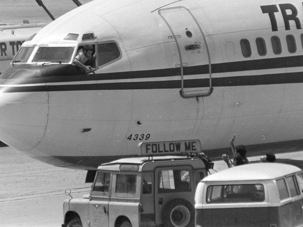 PHOTO: FILE - In this Wednesday, June 19, 1985 file photo, a hijacker points a weapon toward an ABC news media crew from the window of the cockpit of the Trans World Airlines jet at Beirut International Airport, Lebanon.