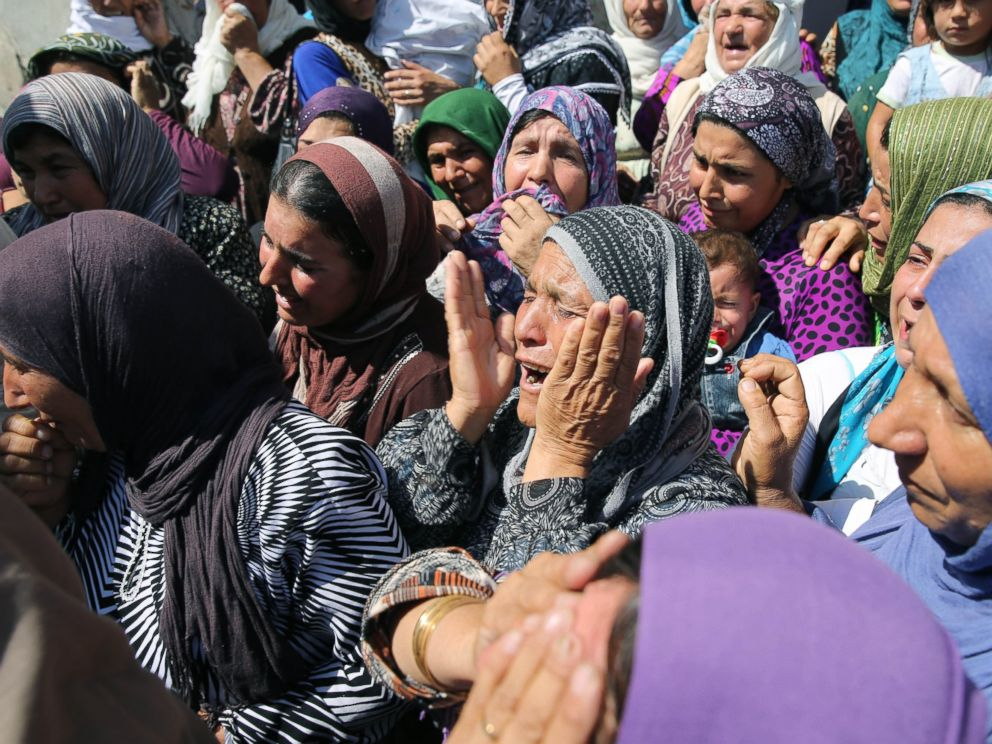 PHOTO: Relatives mourn during funeral of Aylan his brother Galip and their mother Zahin Kurdi, 27, who drowned after their boat sank en route to the Greek islands in the Aegean Sea, in the Syrian border town of Kobani, Sept. 4, 2015.