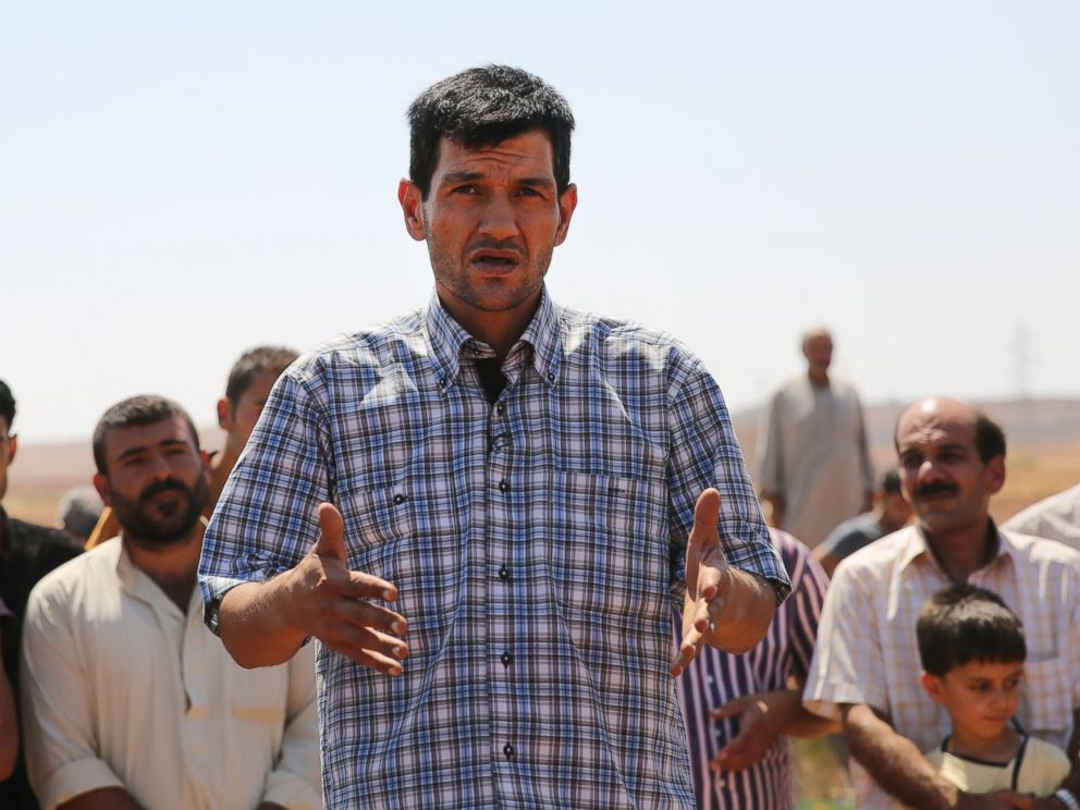 PHOTO: Abdullah Kurdi, father of Syrian children Aylan, Galip, and husband of Rehan, speaks during the funeral of his family in the Syrian border town of Kobani, Sept. 4, 2015.