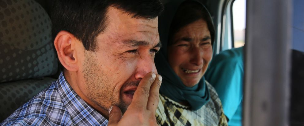 PHOTO: Abdullah Kurdi cries on his way to the Syrian border town of Kobani to hold a funeral for his family, Sept. 4, 2015.