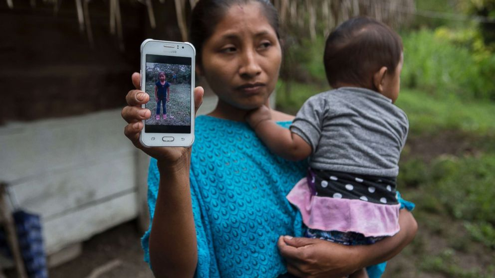 Claudia Maquin, 27, shows a photo of her daughter, Jakelin Amei Rosmery Caal Maquin in Raxruha, Guatemala, Dec. 15, 2018. The 7-year-old girl died in a Texas hospital, two days after being taken into custody by border patrol agents in a remote stretch of New Mexico desert.