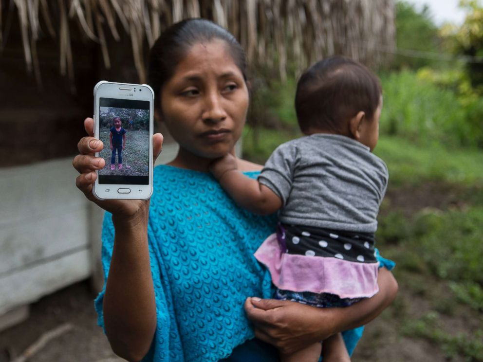 PHOTO: Claudia Maquin, 27, shows a photo of her daughter, Jakelin Amei Rosmery Caal Maquin in Raxruha, Guatemala, Dec. 15, 2018.