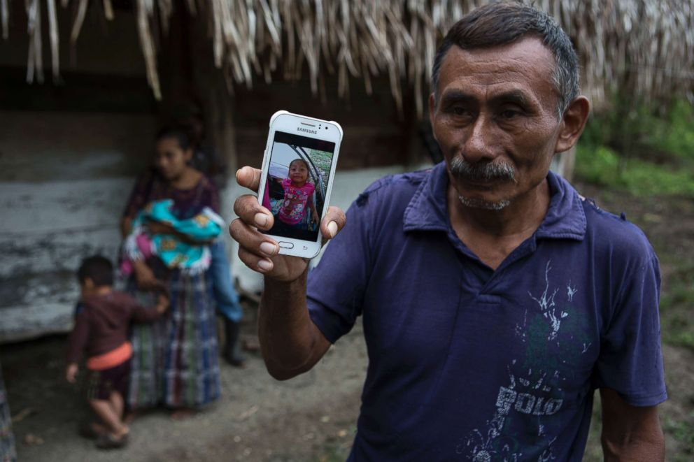 PHOTO: Domingo Caal Chub, 61, holds a smartphone displaying a photo of his granddaughter, Jakelin Amei Rosmery Caal Maquin, in Raxruha, Guatemala, Dec. 15, 2018.