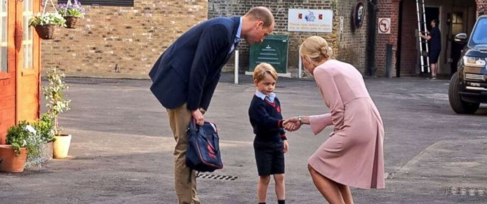 Prince George arrives at Thomass Battersea school on his first day with his father, Prince William, and Helen Haslem, the head of Thomas's lower school, on Sept. 7, 2017.