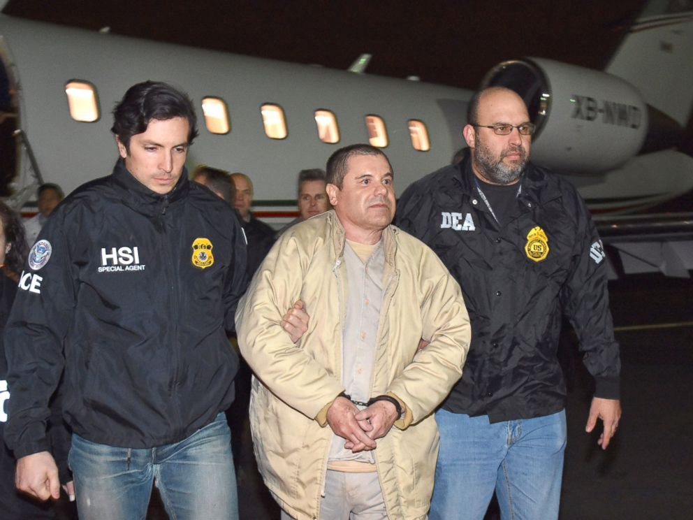 PHOTO: U.S. law enforcement, authorities escort Joaquin El Chapo Guzman, center, from a plane at Long Island MacArthur Airport, Jan. 19, 2017, in Ronkonkoma, N.Y.