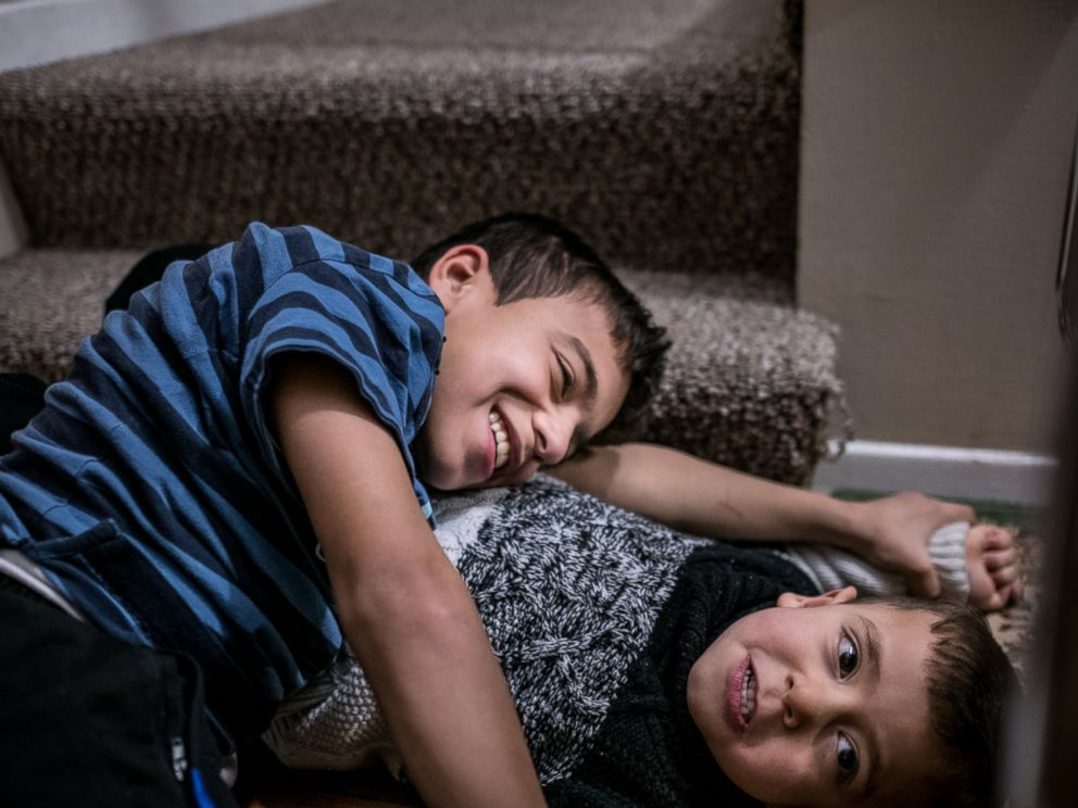 PHOTO: Basel Alrashdan, 11, and his brother Idress, 5, play at home in Charlottetown, on Prince Edward Island, Canada, on December 14, 2016. The Alrashdan family, arrived on Dec 27, 2015, are some of the 250 Syrian refugees that have been settled here.