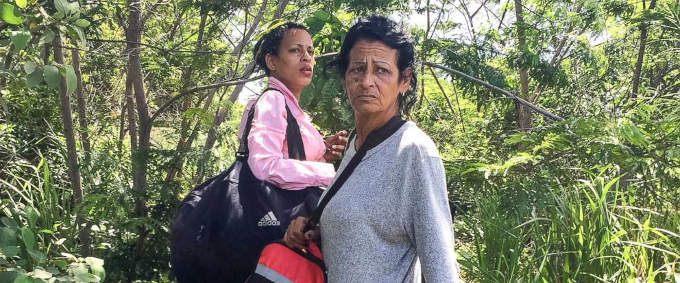 PHOTO: After crossing into Brazil, Marta and Liset wait nervously for the signal to run to awaiting cars.
