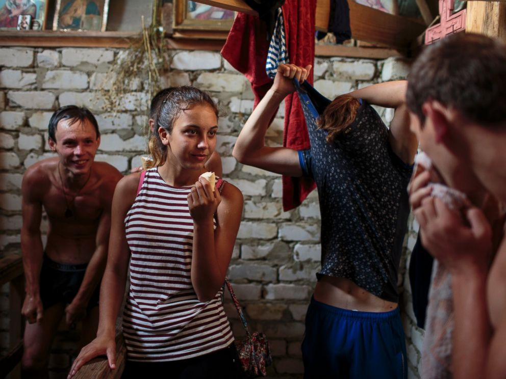 PHOTO: A group of friends from Stavropol undress, swim and shower at a well of freezing, fresh water.