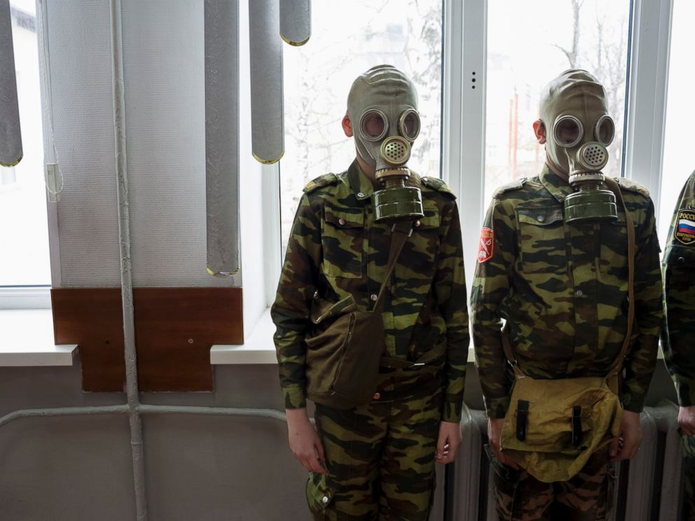 PHOTO: Students stand ready as a teacher observes how quickly they can dress in gas masks, April 4, 2016, at School #7 in Dmitrov, Russia.