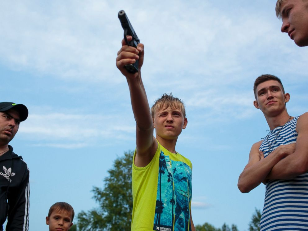 PHOTO: Igor Fast, 14, from Stavropol practices shooting before the start of the Orthodox Warrior camp. They are using air-soft guns for practice and competitions.