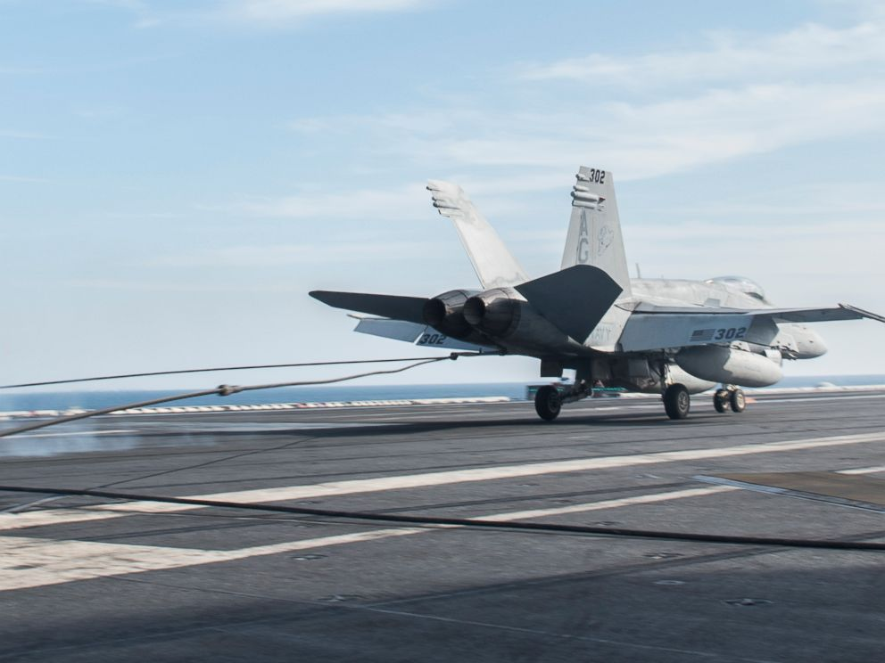 PHOTO: On Dec. 25, 2015, Capt. Frederick Lucky Luchtman completes his 1,000th arrested landing while flying an F/A-18C Hornet on the flight deck of aircraft carrier USS Harry S. Truman (CVN 75).