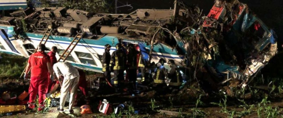 PHOTO: Authorities investigate the scene of a deadly train derailment in northern Italy.